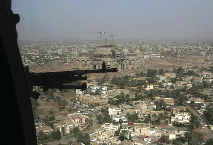 A US helicopter flies over Baghdad on its way to Camp Victory in March 2006.Photo by Ali Jasim\/Reuters